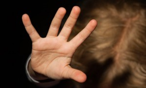 Girl struggling with outstretched hand