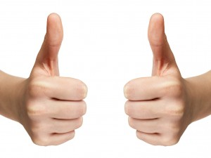 female teen hands shows thumbs up
