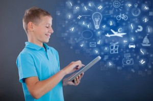 http://www.dreamstime.com/stock-photo-young-boy-using-tablet-school-learning-technology-concept-child-looking-computer-image45407930